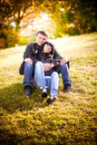Couple in love sitting on hill Royalty Free Stock Photo
