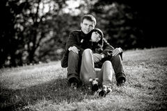 couple in love sitting on lawn Royalty Free Stock Photo
