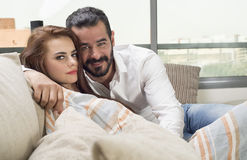 Couple in love sitting in a modern interior Royalty Free Stock Images