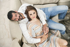 Couple in love sitting in a modern interior Stock Photography