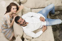 Couple in love sitting in a modern interior Stock Photos
