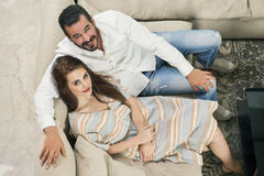 Couple in love sitting in a modern interior Royalty Free Stock Photo