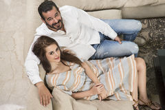 Couple in love sitting in a modern interior Royalty Free Stock Photography
