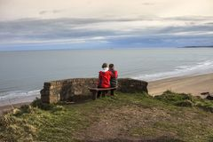 Couple at St Cyrus Beach. Aberdeenshire, Scotland royalty free stock photography