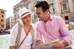 Couple in love sitting on Trevi Foutain of Rome Stock Photos
