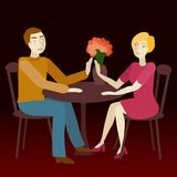 Couple in love sitting vis-a-vis. Stock Images