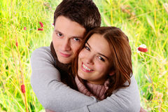 Couple in love smiling and hugging in nature. Young couple smiling in love hugging in nature Stock Photo
