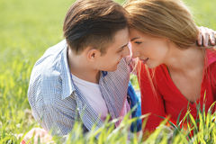 Couple in Love. They are smiling and looking at each other. Royalty Free Stock Photo