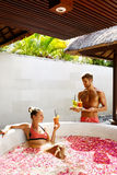 Couple In Love At Spa. Man, Woman On Romantic Vacation. Couple In Love At Spa Resort. Handsome Happy Man Serving Beautiful Smiling Woman Healthy Fresh Detox Stock Photography