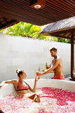 Couple In Love At Spa. Man, Woman On Romantic Vacation. Couple In Love At Spa Resort. Handsome Happy Man Serving Beautiful Smiling Woman Healthy Fresh Detox Stock Photo