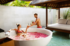 Couple In Love At Spa. Man, Woman On Romantic Vacation. Couple In Love At Spa Resort. Handsome Happy Man Serving Beautiful Smiling Woman Healthy Fresh Detox Royalty Free Stock Photos