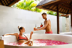 Couple In Love At Spa. Man, Woman On Romantic Vacation. Couple In Love At Spa Resort. Handsome Happy Man Serving Beautiful Smiling Woman Healthy Fresh Detox Stock Image