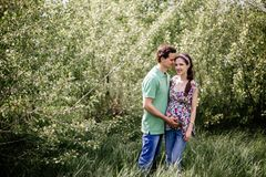 Pregnant couple girl holding her tummy. stock image