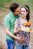 Pregnant couple girl holding her tummy. stock photo