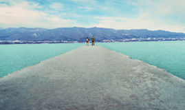 Couple in love standing on pier Royalty Free Stock Image
