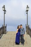 Couple in love standing on stone stairs with lanterns Stock Photography