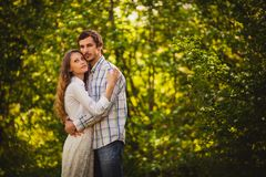 Couple in love standing at summer park Royalty Free Stock Images
