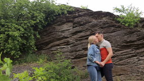 Couple in love standing under the mountain. stock footage