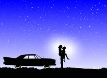 Couple in love on a starry night Stock Photos
