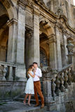Couple in love strolling around an old castle Royalty Free Stock Image