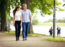 Couple in Love Strolling in a Park Stock Images