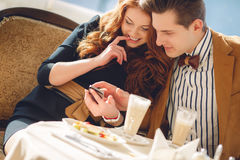 A couple in love in a summer cafe Stock Photos