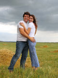 Couple in love in the summer field Stock Photography