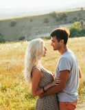Couple in love  in summer time together happy outdoors Royalty Free Stock Image
