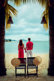 Couple in love at sunset. Beach. Palms Royalty Free Stock Photo