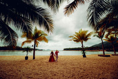 Couple in love at sunset. Beach. Palms Royalty Free Stock Photography