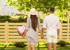 couple in love at sunset walking in the park happy, American dream. The concept of family values. royalty free stock image