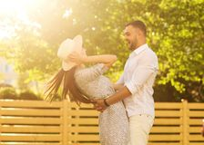 couple in love at sunset walking in the park happy, American dream. The concept of family values. stock images
