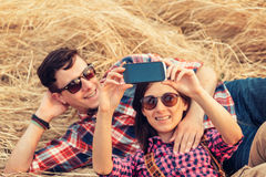 Couple in love takes photographs. Happy couple in love takes photographs self portrait with camera phone Royalty Free Stock Image