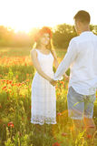Couple in love taking hands together in nature Royalty Free Stock Photos