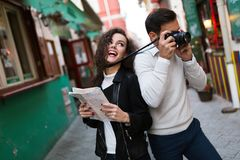 Couple in love taking pictures. And exploring Europe stock images