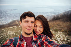 Couple in love taking self-portrait. Traveler young couple in love taking self-portrait on nature outdoor Royalty Free Stock Image