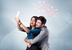 Couple in love taking selfie with red heart Stock Image