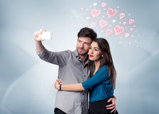 Couple in love taking selfie with red heart Stock Photo