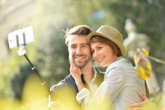 Couple in love taking selfie in the streets royalty free stock images