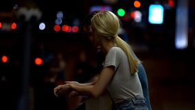 Couple in love talking on city street at night, romantic relationship, dating. Stock photo stock photo