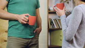 Couple in love talking about something, laughing and drinking coffee. Stock footage stock footage