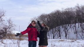 Couple in love throws up snow stock video footage