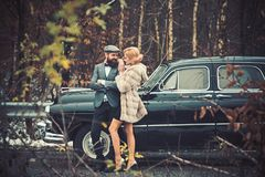 Couple in love on romantic date. Retro collection car and auto repair by mechanic driver. Travel and business trip or royalty free stock photo