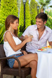 Couple in love toasting outdoors in a warm day Royalty Free Stock Photography