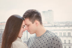 Couple in love touching noses. Outdoors , Shy girl and guy coupled with noses smiling with city view , Profile of couple nose to nose Stock Images