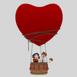 Couple  in love traveling  in Aerostatic Balloon Heart Love. Saint Valentine. Stock Image