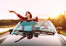 Couple in love traveling by cabriolet Royalty Free Stock Photo