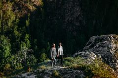 A couple in love travels in the mountains. A guy and a girl traveling in the mountains Royalty Free Stock Photos