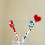 Couple in love of two toothbrushes. Suggesting St. Valentines Day concept. Selective focus. Couple in love of two toothbrushes. Suggesting St. Valentines Day Stock Images