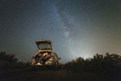 Couple in love under stars of Milky Way Galaxy Stock Photo